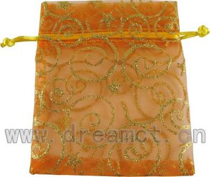 Orange organza bag with gold stars & swirls